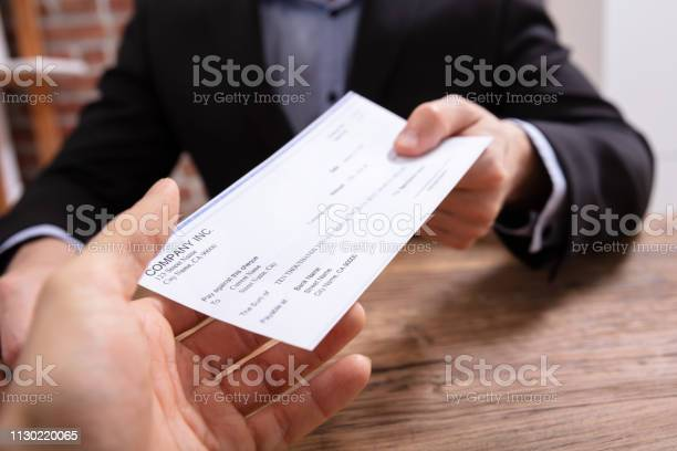 Mans hands giving cheque to other person picture id1130220065?b=1&k=6&m=1130220065&s=612x612&h=8 lnff9gikwihjrlwcdqpvaoapzyq03kcxqh1lssuyg=
