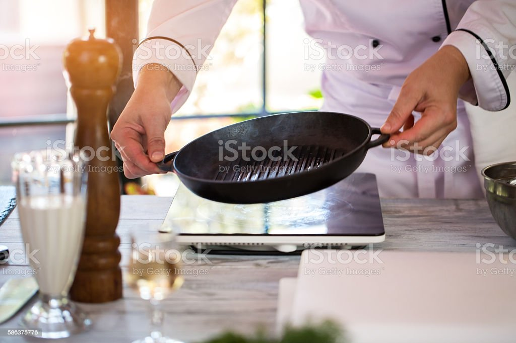 Man's hands hold frying pan. stock photo