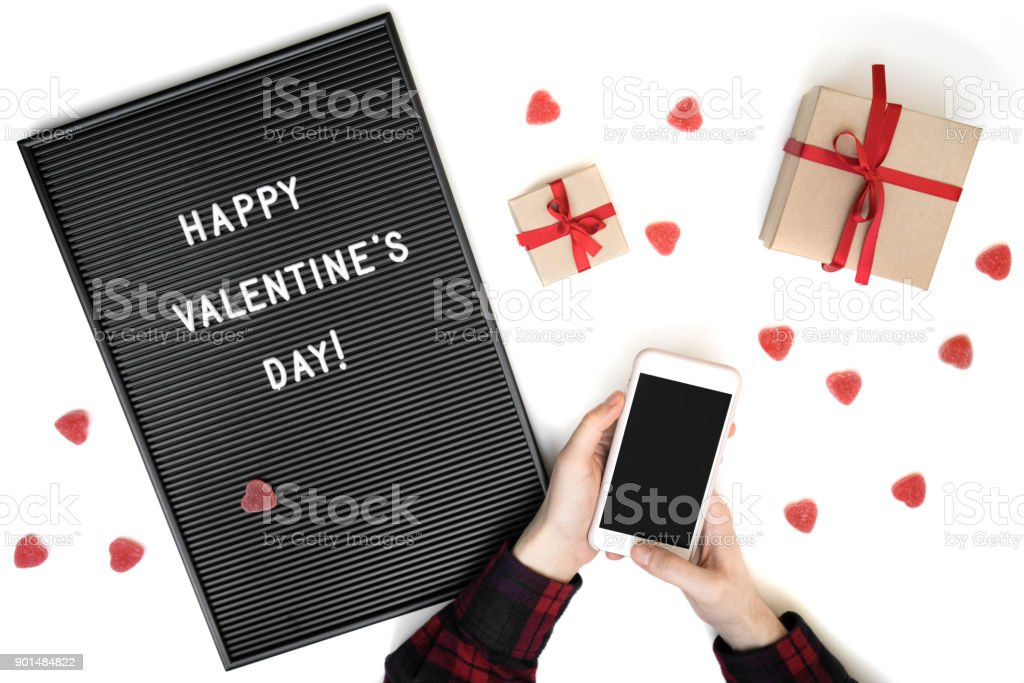 Mans Hands Holding Phone With Empty Screen Valentines Day Background