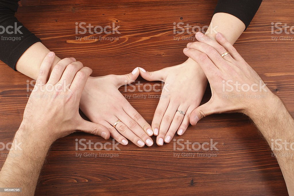Man's hands holding woman's hands royalty-free stock photo