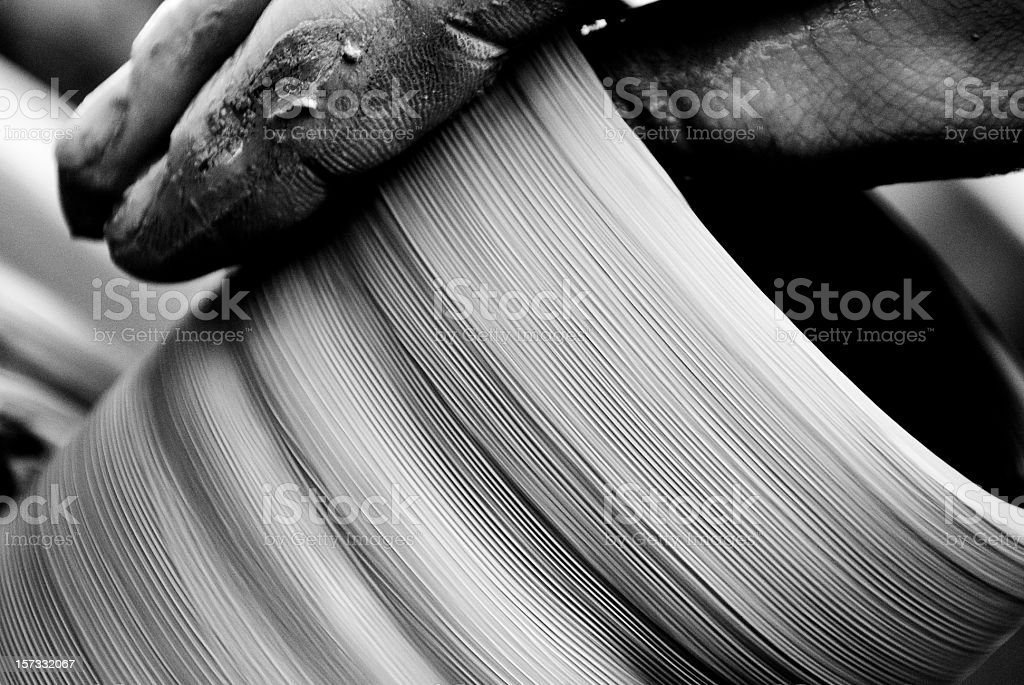 Man's Hands Making Clay Pot on Wheel stock photo