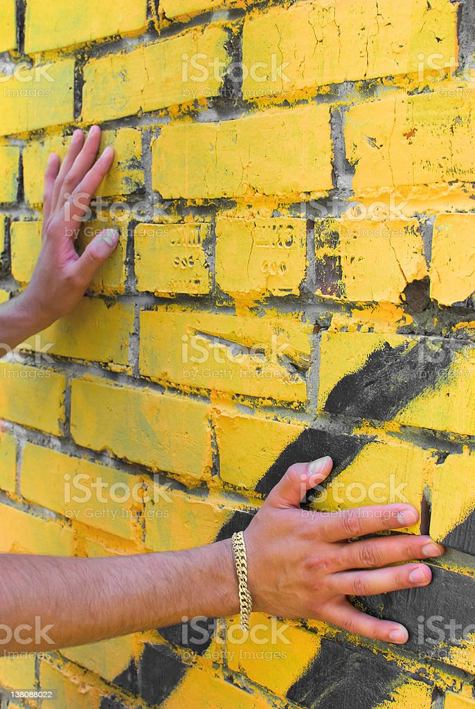 Man's hands on the wall stock photo
