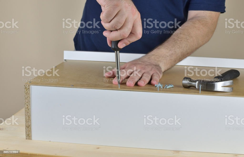 Man's hands screwing foto de stock royalty-free