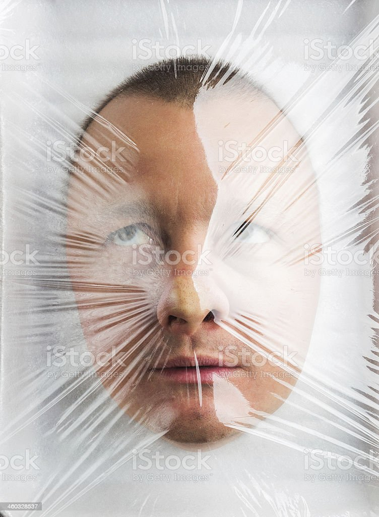 Mans head in food container stock photo