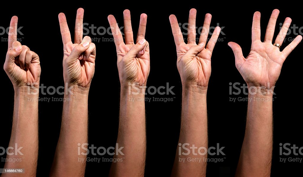 Man's left hand counting from 1 to 5 stock photo