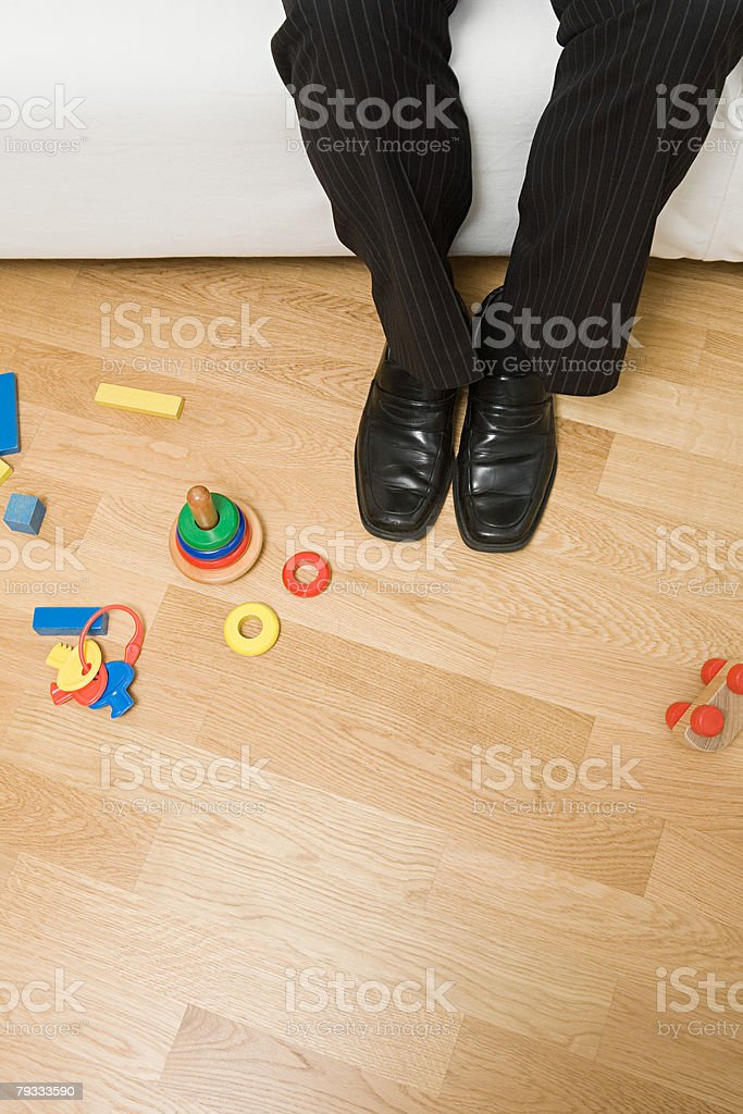 A mans legs and toys 免版稅 stock photo