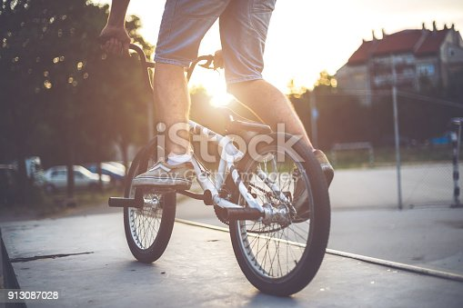 Man`s legs on the bmx bicycle