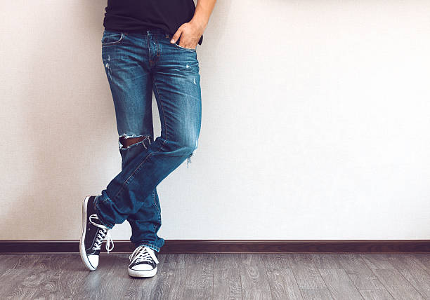 man's legs - jeans stock photos and pictures