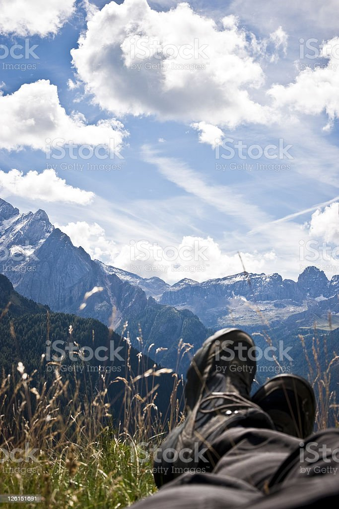 Man's Legs Relaxing in the Alps Mountain Landscape royalty-free stock photo