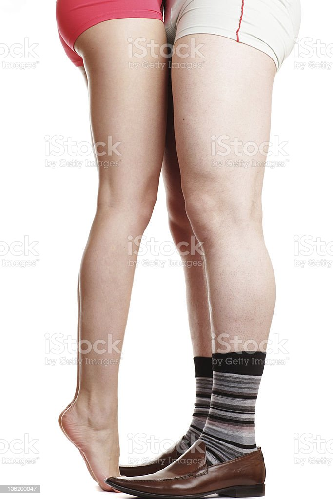 Man's Legs Wearing Shoes and Socks with Woman in Underwear royalty-free stock photo