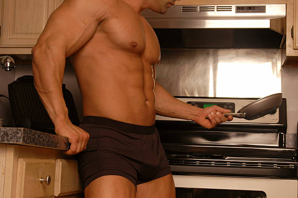 man's place is in the kitchen stock photo