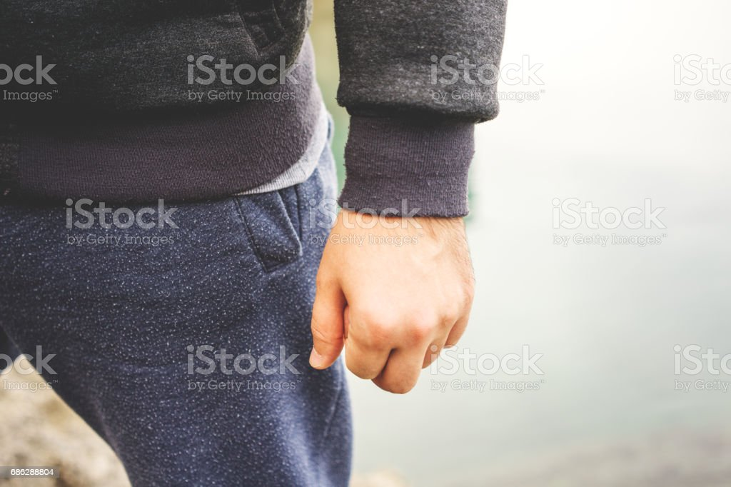 Man's Punch hip level stock photo