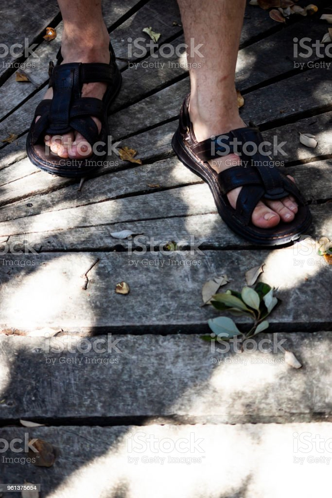 Man´s sandals in the St. Kilda mangroves stock photo