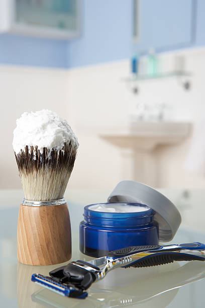 Man's shaving kit in bathroom Man's shaving kit on shelf in bathroom shaving brush shaving cream razor old fashioned stock pictures, royalty-free photos & images