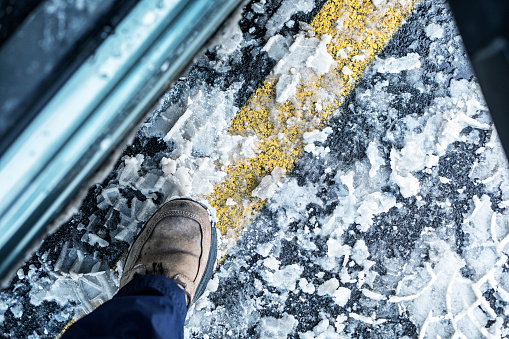 Man's Shoe Entering Car From Winter Parking Lot Slush