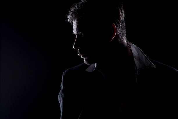 Man's silhouette in the dark stock photo