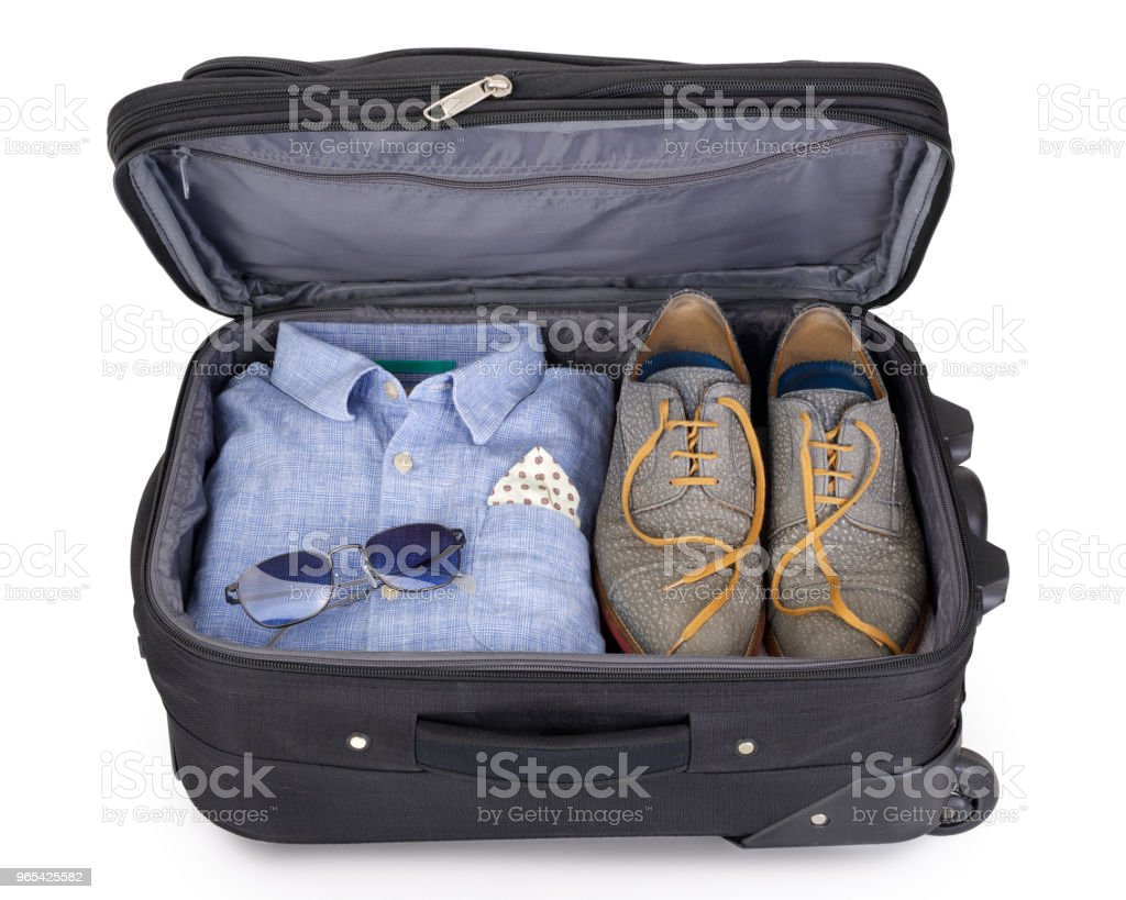 Man's suitcase packed for a short vacation or citytrip zbiór zdjęć royalty-free