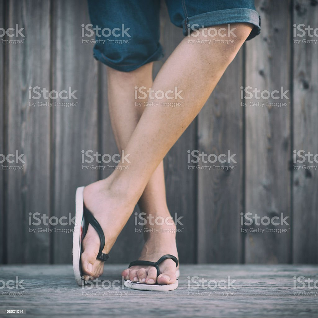 Man's Summer Legs with Flip Flops stock photo