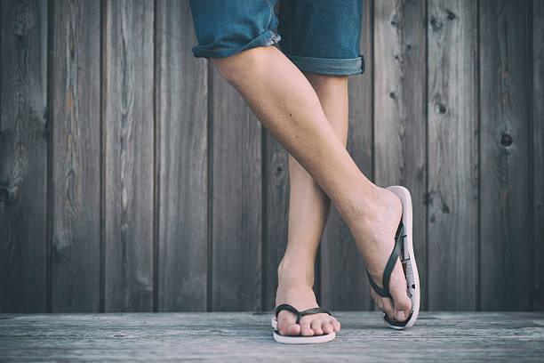 Man's Summer Legs with Flip Flops stock photo