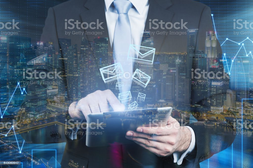 Man's torso, graphs, tablet, forex stock photo