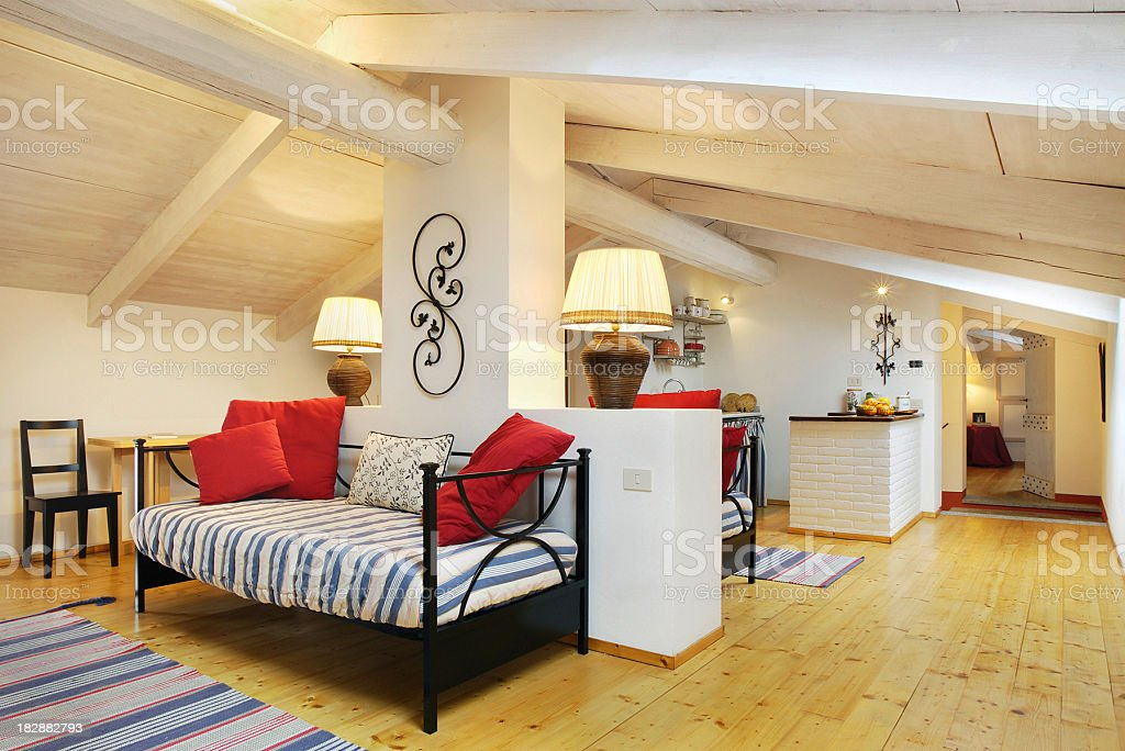 Mansarded wooden room of an italian elegant house stock photo
