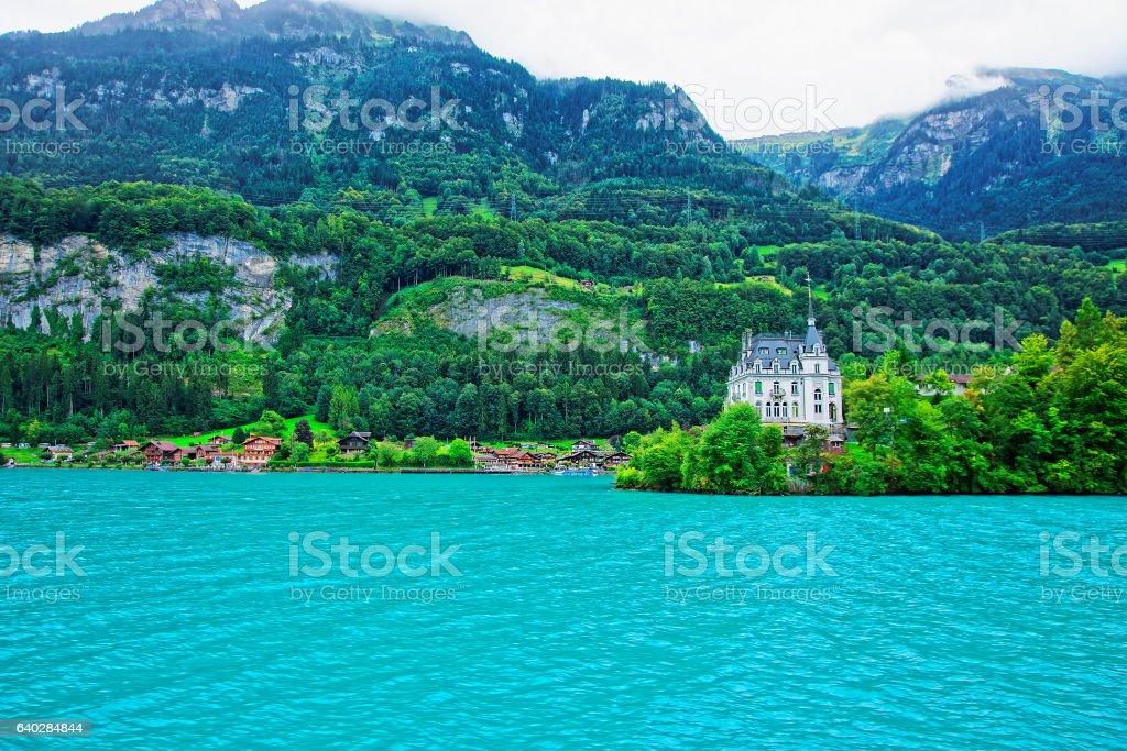 Mansion at Lake Brienz and Brienzer Rothorn mountain Bern Switzerland stock photo