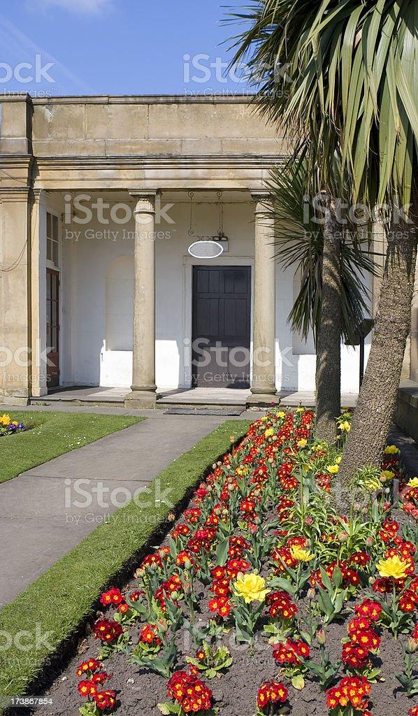 \'Formal ornamental garden at a mansion. Flower bed of primroses....