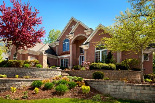 Mansion Home Exterior Design; Terraced Paved Landscape, Colorful Spring Foliage