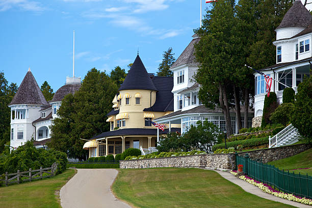 mansions on mackinac island - mackinac island stock photos and pictures