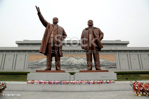 April 13, 2018. Pyongyang, North Korea. Kim Il-Sung and Kim Jong-Il have special posters and monuments in different parts of the city. The most important of these monuments is the giant sculptures of North Korea's founding leader Kim Il-Sung and his son Kim Jong-Il. All tourists who come to visit the country have to come here and show their respects.