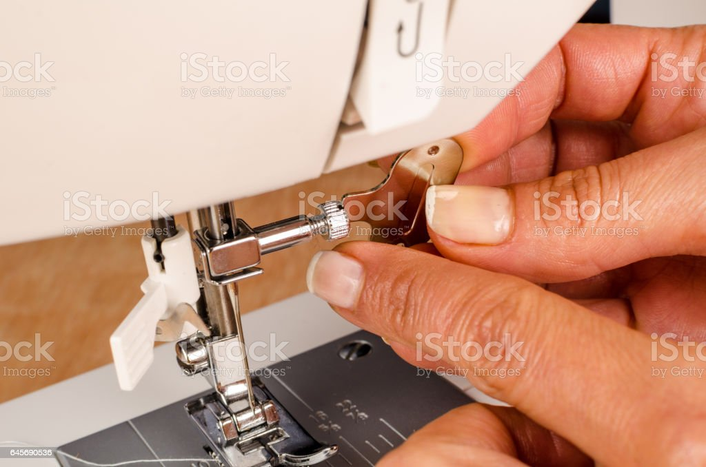 Mantainance of a sewing machine stock photo