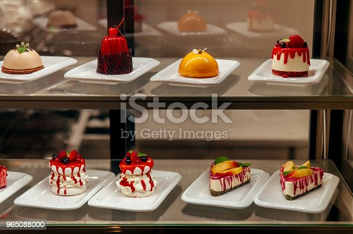 Manu Little Cakes Beyond Showcase In Shop Is On Sale Stock Photo & More Pictures of Baked Pastry Item