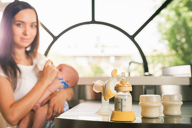 Bomba Manual de mama, madres leche materna - foto de stock