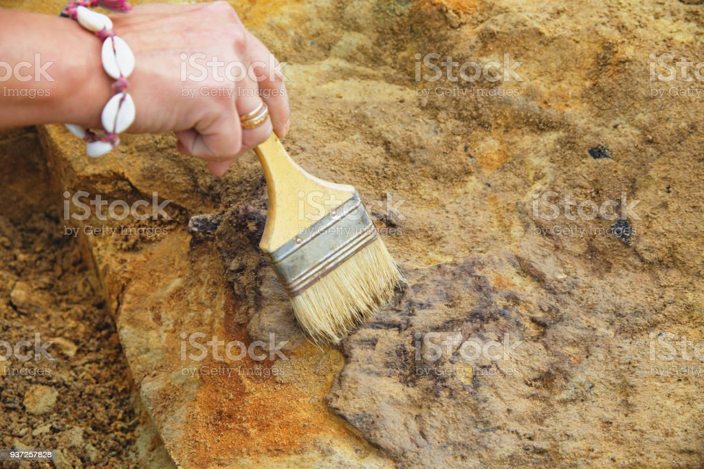 Manual clearing the medieval grave stock photo