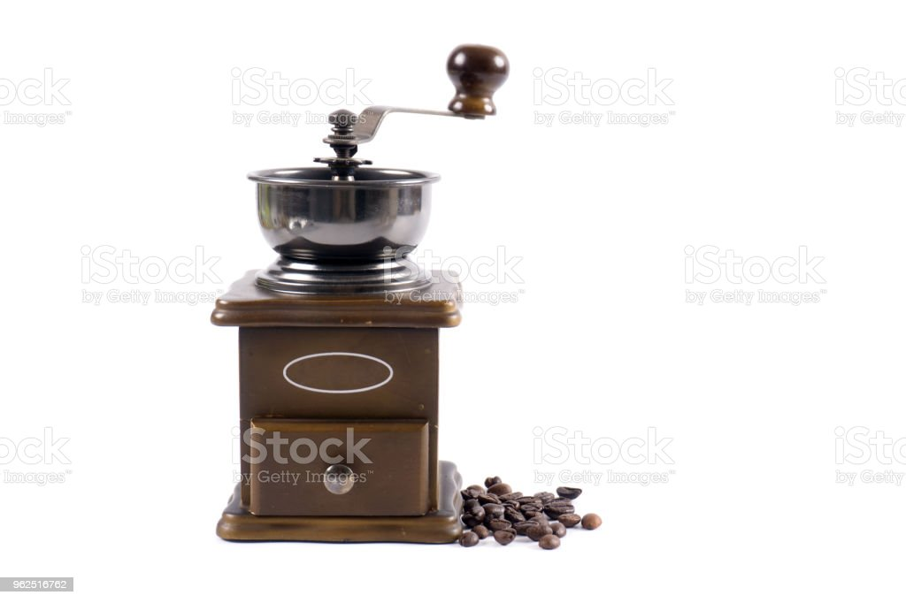 Manual coffee grinder on a white background. - Royalty-free Ancient Stock Photo