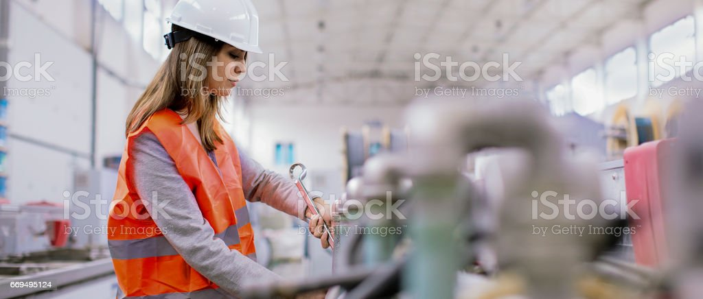 Manual female worker in the factory stock photo