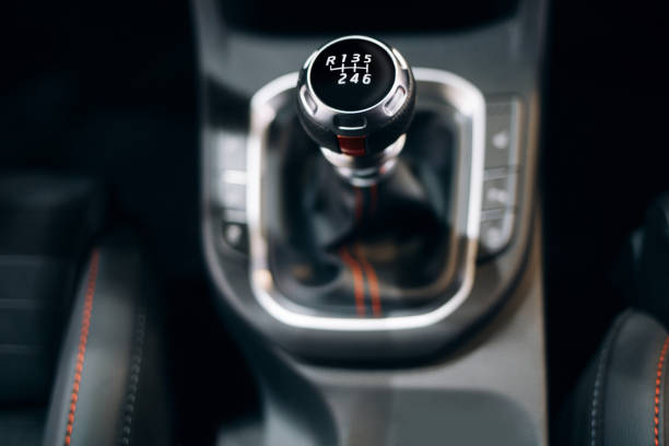 Manual gearbox handle in the modern car Manual gearbox handle in the modern car gearshift stock pictures, royalty-free photos & images