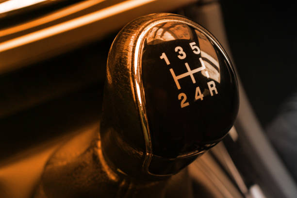 Manual gearbox transmission handle in the car close up Manual gearbox transmission handle in the car close up. gearshift stock pictures, royalty-free photos & images