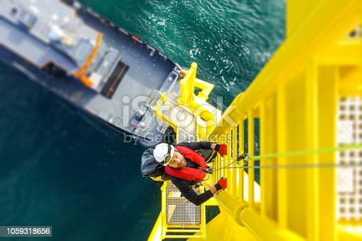 Wind-turbine, offshore, worker, climbing, high up, boat, sea