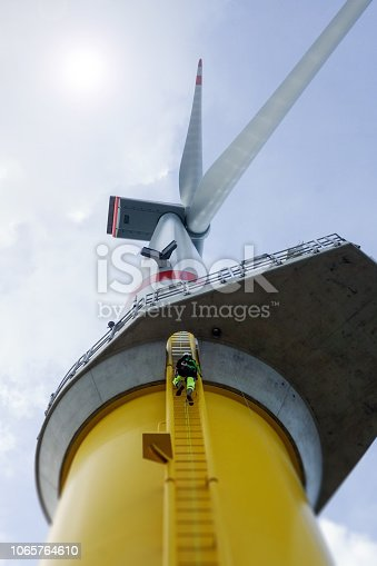 Wind-turbine, offshore, worker, climbing, high up, ladder