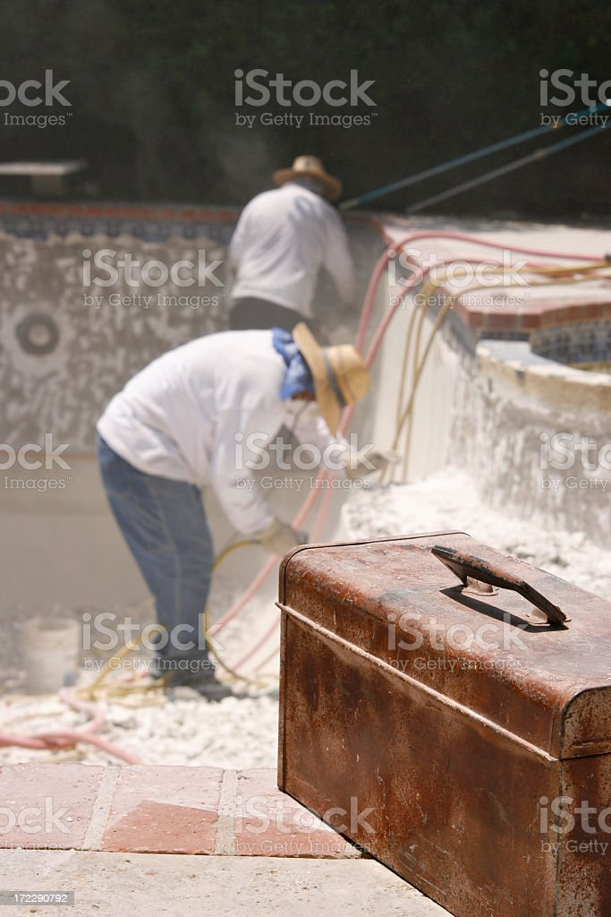 Manual Laborers Fixing the Pool Replastering royalty-free stock photo
