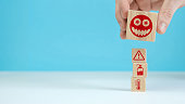 istock Manual organization wood block stacking with health icon coronavirus. Insurance for your health concept 1241443515