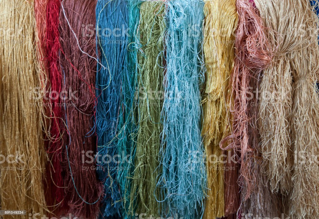 manual production of carpets stock photo