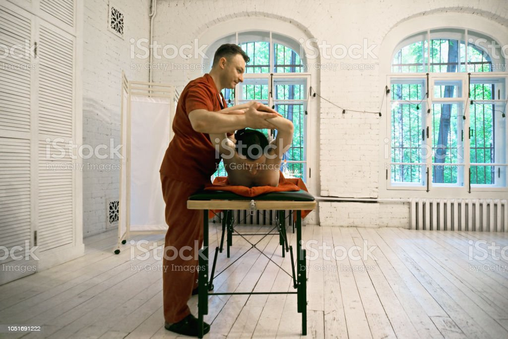 Manual therapist with patient stock photo