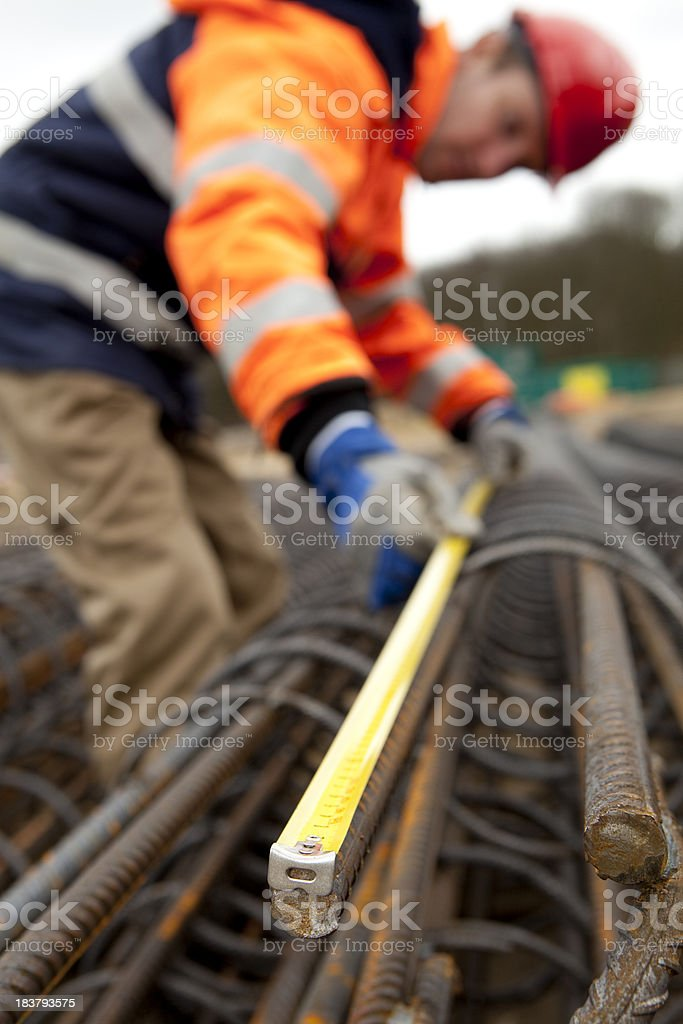 Manual worker busy with road construction. Building a bridge. royalty-free stock photo