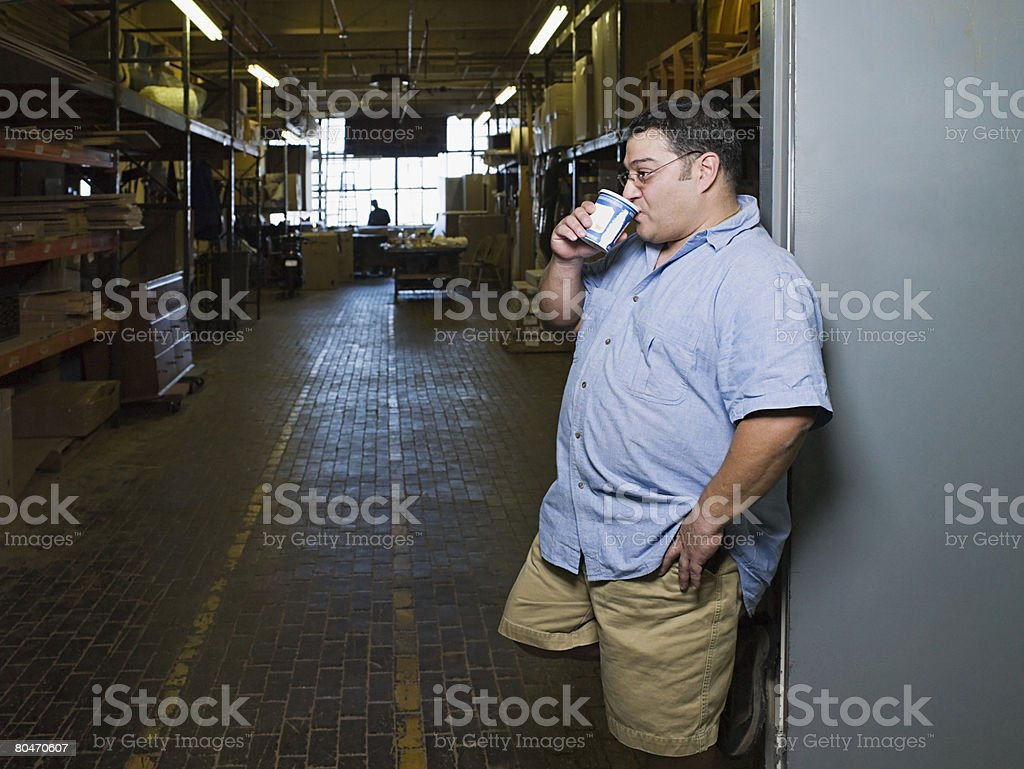 Manual worker drinking coffee royalty-free stock photo