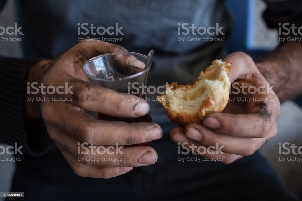 Manual Worker Eating With Dirty Hands stock photo