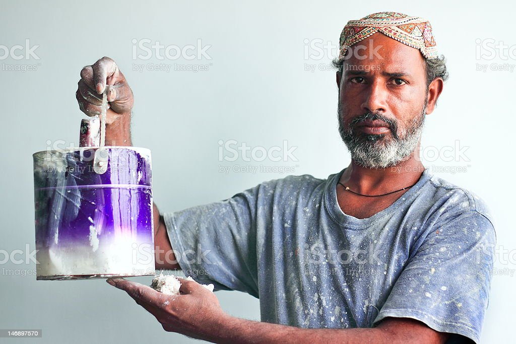 Manual Worker Holding a Paint Bucket royalty-free stock photo