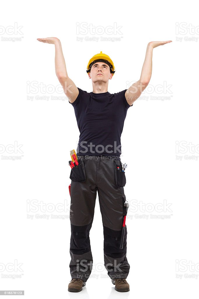 Manual worker holding something over head stock photo