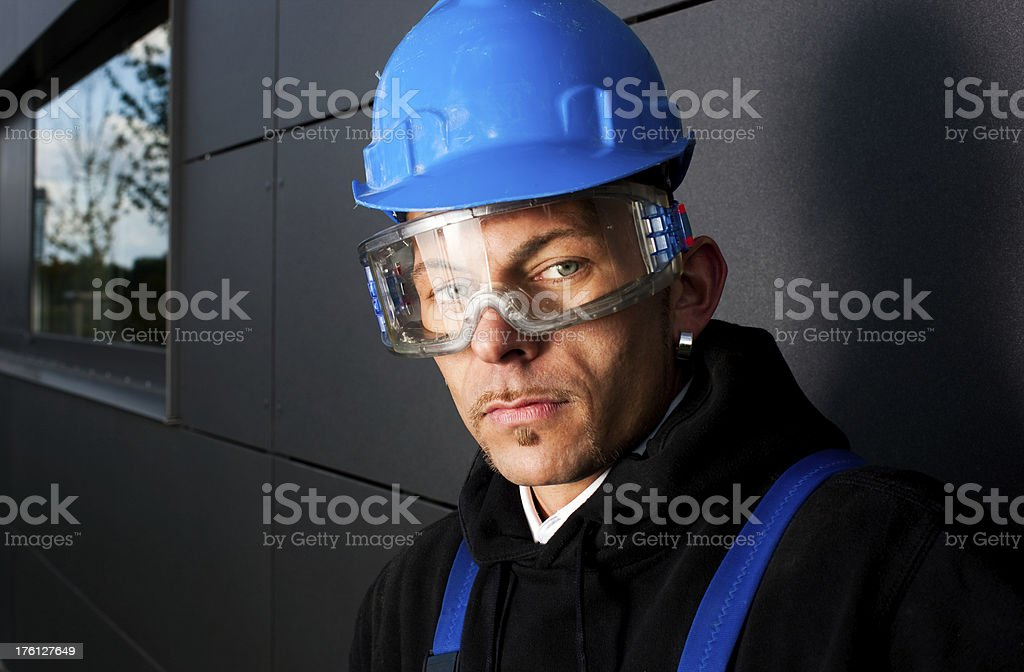 Manual Worker In Blue Hardhat royalty-free stock photo